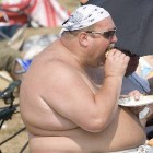 Fat guy on beach