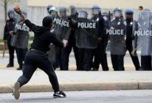 Baltimore burns kid with brick