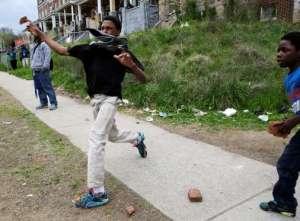 Baltimore burns kids with rocks